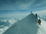 Mountain Climbers Hike along a Ridge to a Mountaintop Photographic Print by Bill Hatcher