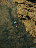 Rock Climber Dangles from a Cliff above a South African Jungle Photographic Print by Bill Hatcher