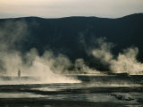Man Stands Amidst Thermal Hot Springs on the Uzon Caldera Photographic Print by Peter Carsten