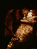 Tibetan Buddhist Monks Light Yak Butter Lamps at a Full Moon Ceremony Photographie par Gordon Wiltsie