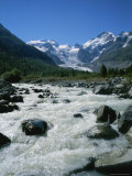 Stream of Glacier Water with its Source Visible in the Background Photographic Print by Taylor S. Kennedy