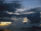 Sunset Reflecting on the South Pacific Through Dramatic Cloud-Filled Sky Photographic Print by Todd Gipstein