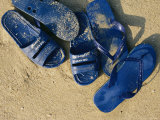 Blue Plastic Sandals, Covered in Sand, Lie on a Beach in Hong Kong Photographic Print