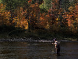 Fly-Fisherman Lays Out a Perfect Cast in Search of Atlantic Salmon Photographic Print by Paul Nicklen