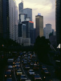 Traffic at Sunset with Hong Kong Skyline in the Background Photographic Print