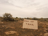 End of Trail Sign in a Bleak Landscape with Cloudy Sky Photographic Print by Charles Kogod