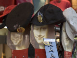 Display of Hats Perch on Cardboard Faces of the Mona Lisa Lmina fotogrfica por Cotton Coulson