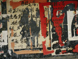 Wall in China with Torn Posters and Graffiti Photographie