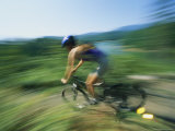 Panned View of a Mountain Biker Rounding a Curve Photographic Print by Stephen Alvarez