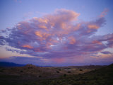 Storm Clouds Gather above a New Mexican Town Photographic Print by Raul Touzon