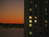 Illuminated Windows Pierce a High-Rise Building at Twilight Photographic Print by Karen Kasmauski