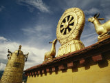 Prayer Wheel, Deer and Wheel of Dharma on the Roof of the Jokhang Photographic Print