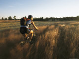 Young Woman Mountain Biking on the Centennial Trail Photographic Print by Bobby Model