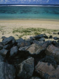 Calm Surf Breaking on Sandy Shore with Dark Stones in Foreground Photographic Print by Todd Gipstein