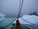 Fishing Boats Maneuver Around Icebergs near the Ilulissat Glacier Photographic Print by Sisse Brimberg