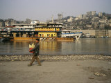 Vendor Who Sells Sugar Cane to Boat Passengers Walks near the River Photographic Print