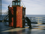 Men Move a Container on the Rowan Gorilla, an Oil Rig Platform Photographic Print by Justin Guariglia