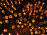 Candles Burn in a Church Courtyard during Corpus Christi Photographic Print by Stephen Alvarez