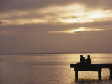 Two People Fishing on a Pier Looking Out at Sunset over the Pacific Ocean Photographic Print by Todd Gipstein