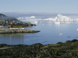 Icebergs from the Ilulissat Glacier Float by a Fishing Plant Photographic Print by Sisse Brimberg