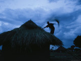 Sudanese Refugee Works on his Thatch Roof Before the Rainy Season Begins Photographic Print by Stephen Alvarez