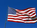 American Flag Flies in a Clear Blue Sky Photographic Print by Stephen Alvarez