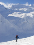 A Back-Country Snowboarder Descends a Snowfield Toward a Glacier Photographic Print by Skip Brown