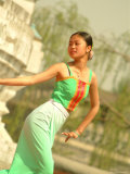 A Dancer Performs at the Chinese Ethnic Culture Park Photographic Print by Richard Nowitz