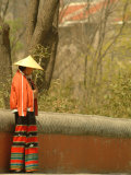 A Chinese Woman in a Straw Hat and Colorful Pants Photographic Print by Richard Nowitz