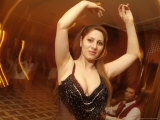 A Belly Dancer Entertains at the Sheraton Hotel Dinner Theater Photographic Print by Richard Nowitz