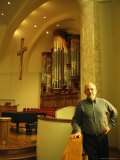 An Organ Manufacturer in a Church with One of His Companys Organs Photographic Print by Joel Sartore