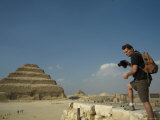A Tourist Photographs the Step Pyramid of Djoser Photographic Print by Richard Nowitz