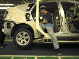 An Auto Worker Assembling a Hybrid Car at Plant in Japan Photographic Print