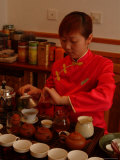 A Salesperson Prepares Samples of Tea for Tourists Photographic Print by Richard Nowitz