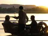 A Waiter Serves Drinks Aboard a Sunset Cruise on the Nile River Photographic Print by Richard Nowitz