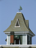 A Sailboat-Shaped Weather Vane Atop the Orleans Inn Photographic Print by Darlyne A. Murawski
