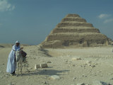 An Egyptian Man and Donkey at the Step Pyramid of Djoser Photographic Print by Richard Nowitz