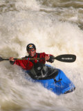 Whitewater Kayaker Surfing a Large Standing Wave Photographic Print by Skip Brown