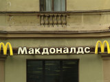 A Sign for Mcdonalds Written in Russian Photographic Print by Richard Nowitz
