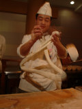 Chef Twirls Dough as He Makes Fresh Noodles in a Restaurant Photographic Print by Richard Nowitz