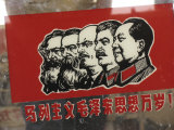 A Window Decal of Communist Leaders Photographic Print by Richard Nowitz