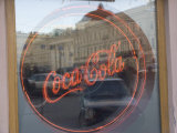 A Neon Coca Cola Sign is Displayed in a Window Photographic Print by Richard Nowitz