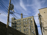 Power Lines Drape Between Buildings in Milwaukees Third Ward Photographic Print by Paul Damien