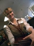 A Smiling Waitress Distributes Menus Photographic Print by Richard Nowitz