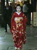 Kimono-Clad Geisha Walks Past Shops Among Other Pedestrians Photographic Print