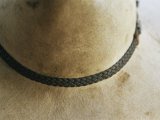 Close View Detail of the Hat Band on a Dirty Cowboy Hat Photographic Print by Jason Edwards