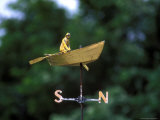 A Weather Vane with a Rowboat and Skipper Figurine Atop It Photographic Print by Darlyne A. Murawski
