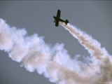A Stunt Bi-Plane in a Steep Dive Trails Smoke at the Avalon Airshow Photographic Print by Jason Edwards