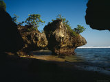 Small Sunlit Trees Sit on Top of the Giant Rocks of Bingin Beach Photographic Print