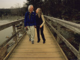 A Couple Enjoys a Walk on the Great Falls Canal Towpath Photographic Print by Raymond Gehman